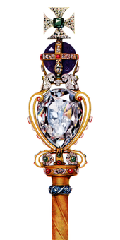 Gold rod surmounted by a large diamond, itself supporting a large round amethyst, on top of which is a cross made of diamonds with an emerald at its centre.