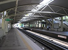 A platform area in a bright new railway station.