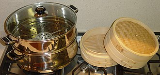 Steaming - Two types of steaming vessels, metal and wood with bamboo