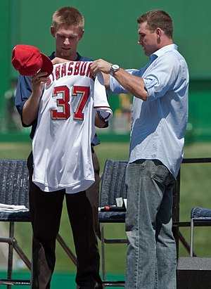 Stephen Strasburg - Strasburg (left) receiving a Nationals uniform from Ryan Zimmerman, August 2009