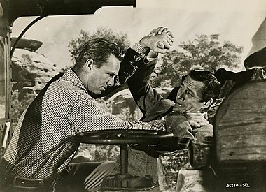 Avec Sterling Hayden (à g.), dans Kansas Pacific (1953, photo promotionnelle)