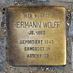Photo of Hermann Wolff brass plaque