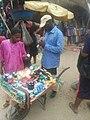 Street hustler selling with a barrow.jpg