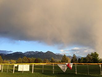 Sugar House Park - The park's softball field under a rainbow in a spring rainstorm, with the Wasatch Range in the background