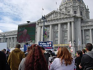 A crowd of people gather in front of the Calif...