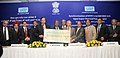 Sushil Kumar Shinde being presented a dividend cheque by the CMD, NTPC, Shri Arup Roy Choudhury, at the synchronization of the NTPC's 1st 660 MW Unit of Sipat Super Thermal Power Project, in New Delhi on February 14, 2011.jpg