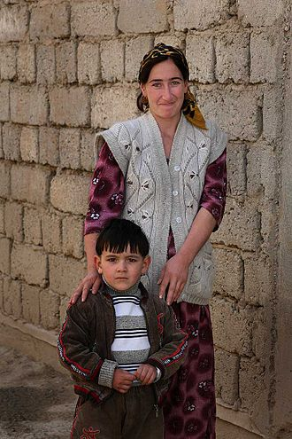 Demographics of Tajikistan - A Tajik woman and her son.