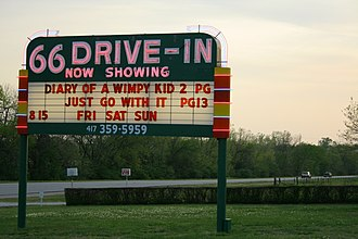 66 Drive-In - Illuminated neon sign at the 66 Drive-in