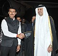 The Emir of the State of Qatar, His Highness Sheikh Tamim Bin Hamad Al-Thani being received by the Minister of State for Information & Broadcasting, Col. Rajyavardhan Singh Rathore, on his arrival, at Air Force Station Palam.jpg