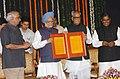 The Prime Minister, Dr. Manmohan Singh presenting a memento to the former Chairman, Rajya Sabha, Shri Bhairon Singh Shekhawat, in New Delhi on August 07, 2007.jpg