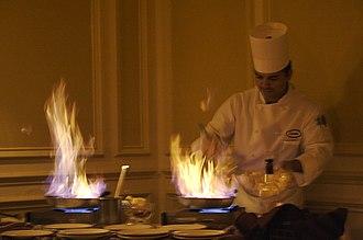 Flaming beverage - A chef preparing Crêpe Suzette