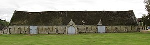Tisbury, Wiltshire - The thatched 15th-century tithe barn at Abbey Grange Place