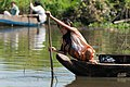 Tonle Sap Siem Reap Cambodia Girl-steering-her-boat-01.jpg