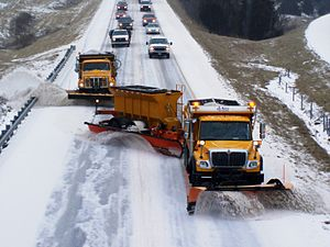 Snowplow - TowPlow and trucks on a Missouri rural Interstate