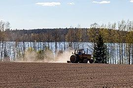 Tractor plowing fields in Hämeenkyrö, Finland (May 2020).jpg
