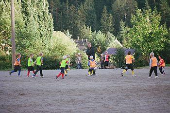 Kids playing football outside Turku