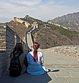 Two young women sitting on the Great Wall of China.jpg