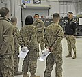 U.S. Air Force Col. Aaron Steffens, the vice commander of the 455th Air Expeditionary Wing, addresses Airmen with the 455th Expeditionary Aircraft Maintenance Squadron at Bagram Airfield, Afghanistan, Jan. 3 140103-F-BJ707-041.jpg