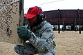 U.S. Air Force Tech. Sgt. Michael Bryant, a combat arms instructor with the 169th Security Forces Squadron, South Carolina Air National Guard, checks targets on the firing range at McEntire Joint National Guard 131208-Z-WT236-033.jpg