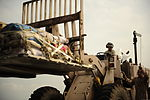 U.S. Airmen load supplies onto a C-130H Hercules aircraft assigned to the 746th Expeditionary Airlift Squadron in support of relief efforts for Pakistan at Pakistan Air Force Base Chaklala, Pakistan, Aug. 22 100822-F-KV470-085.jpg