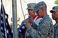 U.S. Army Sgt. Maj. Shane Aki, right, watches as Pfcs 130721-A-FP002-007.jpg