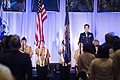 U.S. Coast Guard Lt. Cmdr. Susan Shanahan, background right, sings the national anthem during the opening ceremonies of the 2013 Joint Women's Leadership Symposium at the Gaylord National Resort and Convention 130606-D-HU462-036.jpg