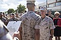 U.S. Marine Corps Lance Cpl. Antonio C. Galloway, center, an aircraft communications, navigation, electrical and weapon systems technician with Marine Medium Tiltrotor Squadron (VMM) 264, stands at attention 140903-M-IU187-068.jpg