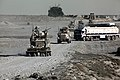 U.S. Marine vehicles lead civilian fuel trucks during an escort mission outside Shir Ghazay, Helmand Province, Afghanistan, October 19, 2011 111019-M-KL854-013.jpg