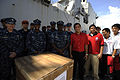 U.S. Navy Cmdr. Antonio Hull, center, commanding officer of USS Harpers Ferry (LSD 49), and other Sailors stand for a photo with Philippine National Red Cross personnel in Subic Bay, Philippines, Oct. 25, 2010 101025-N-OX597-008.jpg