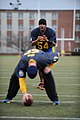 U.S. Navy Lt. Cmdr. Alex Hampton, top, a student at the Naval War College (NWC), calls for the snap during an Army-Navy flag football game at Nimitz Field at Naval Station Newport in Newport, R.I., Dec. 6, 2013 131206-N-PX557-189.jpg