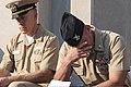 U.S. Navy Lt. David Duprey, left, a chaplain, and Aviation Boatswain's Mate 1st Class Erik Scott, both assigned to the aircraft carrier USS Abraham Lincoln (CVN 72), observe a moment of silence during a 9-11 130911-N-XP477-110.jpg