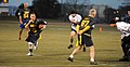 U.S. Navy Senior Chief Sonar Technician (Surface) Ben Pierson, second from left, the senior enlisted adviser for the U.S. Naval War College (NWC), runs for a first down during an Army-Navy flag football game 131206-N-PX557-300.jpg