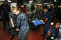 U.S. Sailors carry a simulated victim on the mess decks during a mass casualty training exercise aboard the aircraft carrier USS George H.W. Bush (CVN 77) in the Atlantic Ocean May 21, 2013 130521-N-CZ979-153.jpg