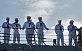U.S. Sailors stand ready for the guided missile destroyer USS Chung-Hoon (DDG 93) to depart Joint Base Pearl Harbor-Hickam, Hawaii, April 2, 2013, for a deployment to the U.S. 7th Fleet area of responsibility 130402-N-WF272-026.jpg