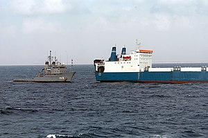 USNS Catawba (T-ATF-168) - Catawaba, left, supplies the Faina, right.