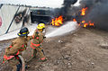 US Navy 021022-N-5362A-011 Fire fighting training during Diligent Warrior 2003.jpg