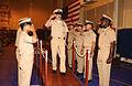 US Navy 030915-N-6803B-061 Chief Electronics Technician Michael Mihok walks across a brow as sideboys render honors.jpg