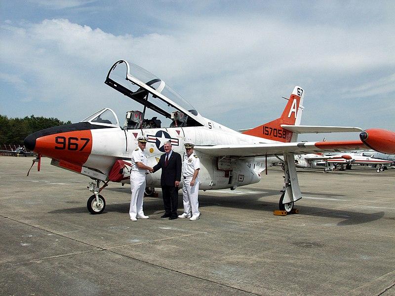 US Navy 040409-N-1914G-001 Capt. Daniel Ouimette, Commodore, Training Air Wing One (TW-1), left, presents the last T-2C Buckeye.jpg