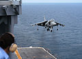 US Navy 040712-N-0938S-003 An AV-8B II Harrier assigned to the Bulldogs of Marine Attack Squadron Two Two Three (VMA-223) hovers above the amphibious assault ship USS Saipan (LHA 2) during touch and go maneuvers.jpg