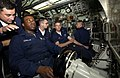 US Navy 040815-N-6811L-017 USS Portsmouth (SSN 707) Diving Officer of the Watch, Senior Chief Store Keeper Albert Holguin, gives instruction to Fireman Joel Johnson on proper operating procedures for the Helmsman.jpg