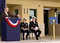 US Navy 050310-N-9197B-002 Former classmate of Capt. John E. Meyers, Dave Reppard presents a plaque during a dedication ceremony of the Command, Control, Computers, Communications and Intelligence (C4I) building on board Naval.jpg