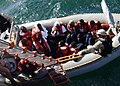 US Navy 050430-N-5526M-043 Sailors aid men and women after their boat, a fishing vessel, capsized 25 miles off the coast of Somalia.jpg