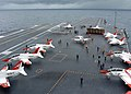 US Navy 050624-N-0535P-006 A T-45A Goshawk trainer aircraft assigned to Training Air Wings One and Two cover the flight deck aboard the Nimitz-class aircraft carrier USS Harry S. Truman (CVN 75).jpg