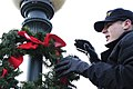 US Navy 051128-N-6477M-057 Information Systems Technician Seaman Patrick M. Rhodes assigned to the guided missile frigate USS Ingraham (FFG 61) helps to put up Christmas ornaments around Naval Station Everett.jpg