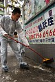 US Navy 060218-N-5334H-127 Electronics Technician 2nd Class Mike Chu, cleans a wall at the Hong Kong Society for the Protection of Children, during a community service project conducted by Sailors assigned to the amphibious com.jpg
