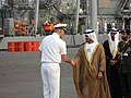 US Navy 070219-N-0000O-001 Cmdr. Scott Davies, commander, Mine Countermeasures Division (MCMDIV) 31, greets Sheikh Sultan bin Tahnoon Al Nahyan, chairman of Abu Dhabi Tourism Authority.jpg