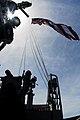 US Navy 070323-N-9928E-021 Sailors from navigation department hoist the American flag aloft from the signal bridge aboard Nimitz-class aircraft carrier USS John C. Stennis (CVN 74).jpg
