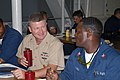 US Navy 070711-N-8102J-047 Commander, U.S. Fleet Forces Command, Fleet Master Chief Rick West chats with Cryptologic Technician (Administration) 1st Class Ronald Revels.jpg