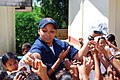 US Navy 071030-N-0120A-147 Storekeeper Seaman Megan Antunes, passes out small gifts to students from the Iram School.jpg