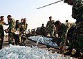 US Navy 071123-M-7696M-099 Bangladeshi soldiers use a stretcher to unload a shipment of bottled water delivered by Marines of Marine Medium Helicopter Squadron (HMM) 261.jpg